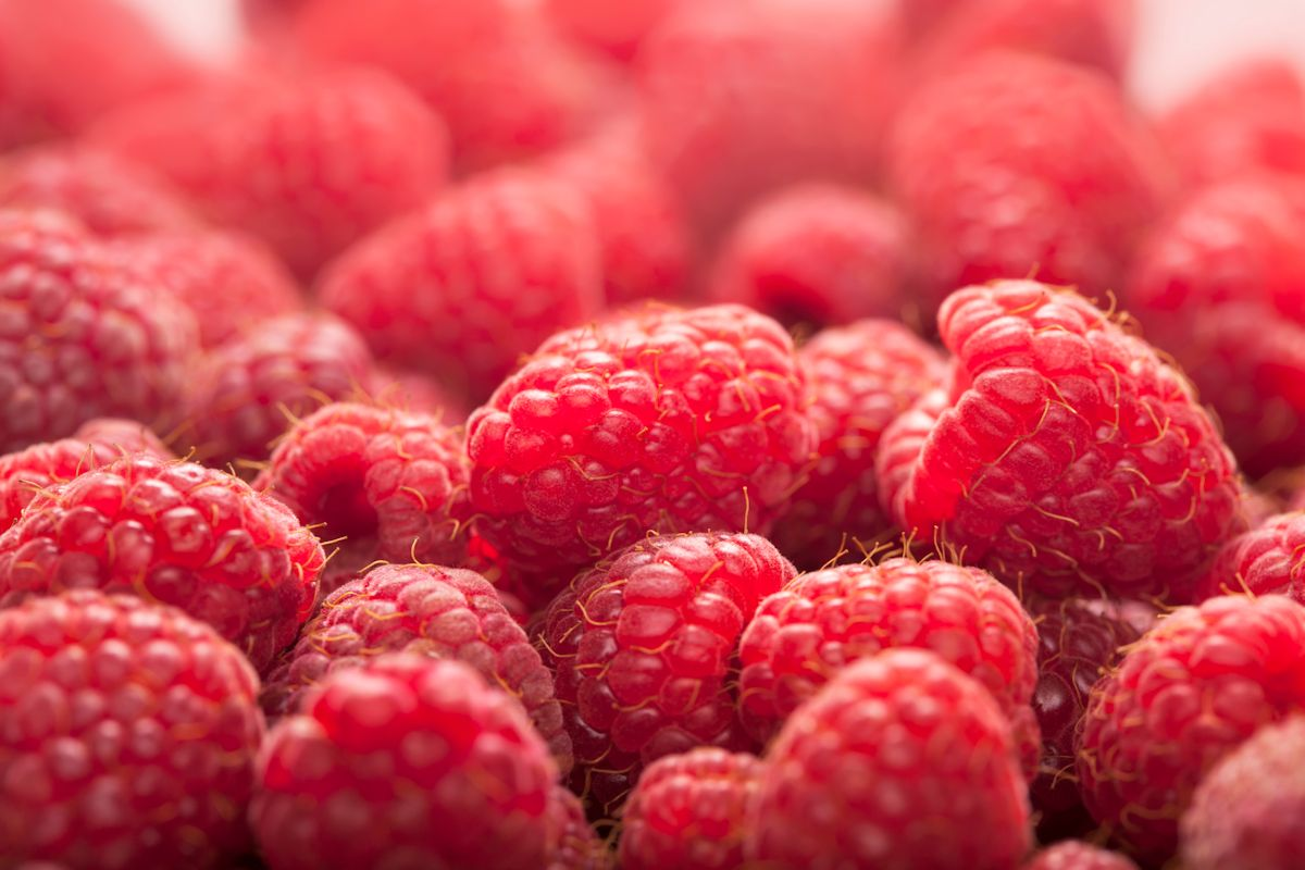 Background ripe juicy raspberries