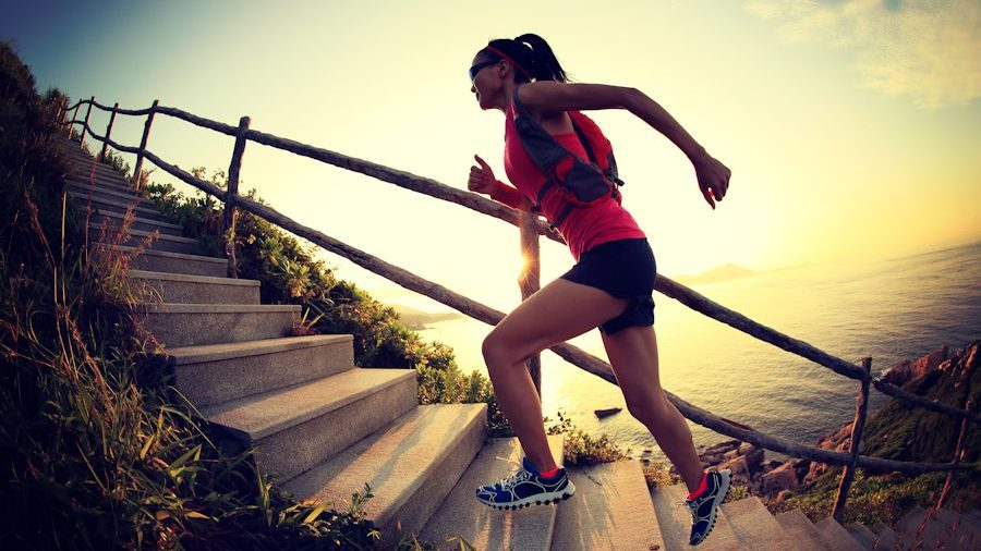 Fitness woman running up stairs